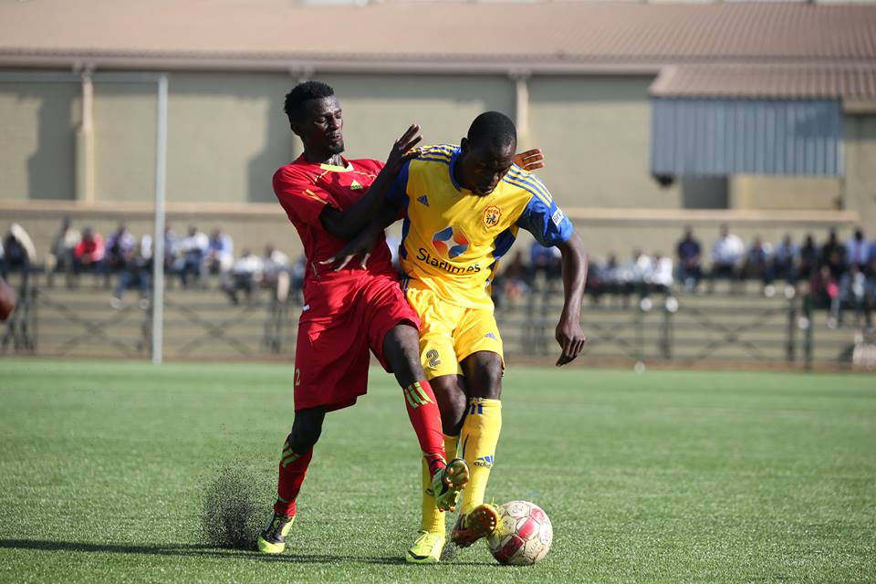 KCCA FC defender Habib Kavuma (R) shields off a Saints players in a league tie at Lugogo, Kavuma returns against URA after missing the game against Sadolin