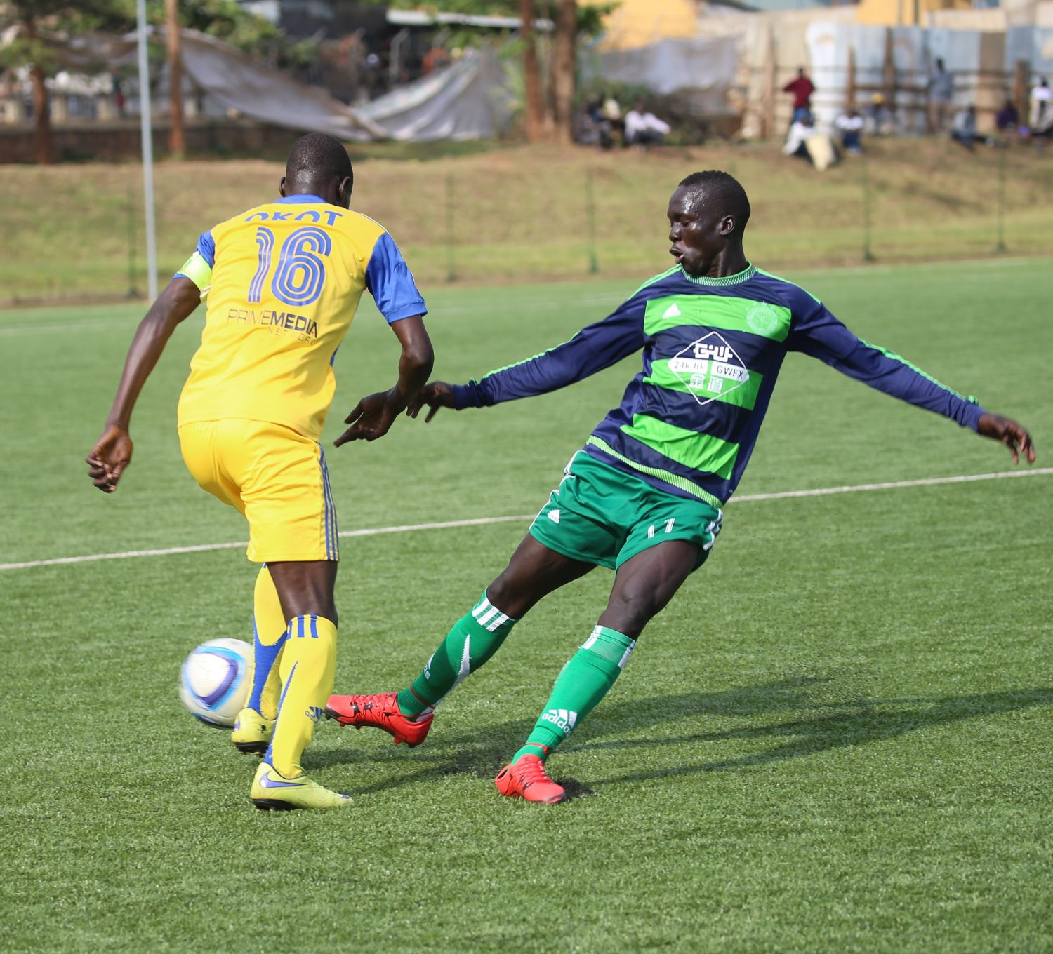 KCCA FC captain Denis Okot (L) beats his man during the FUFA Uganda Cup Round of 64 at Lugogo, KCCA FC won the tie 6-1 to advance to the round of 32