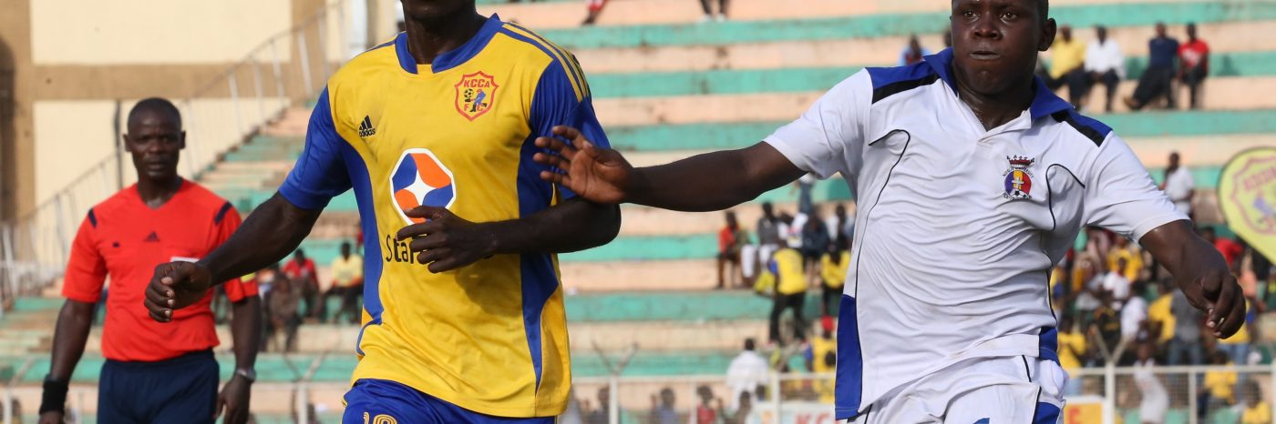 KCCA FC midfeider Muzamir Mutyaba (L) against Ndejje University during last season's Uganda Cup